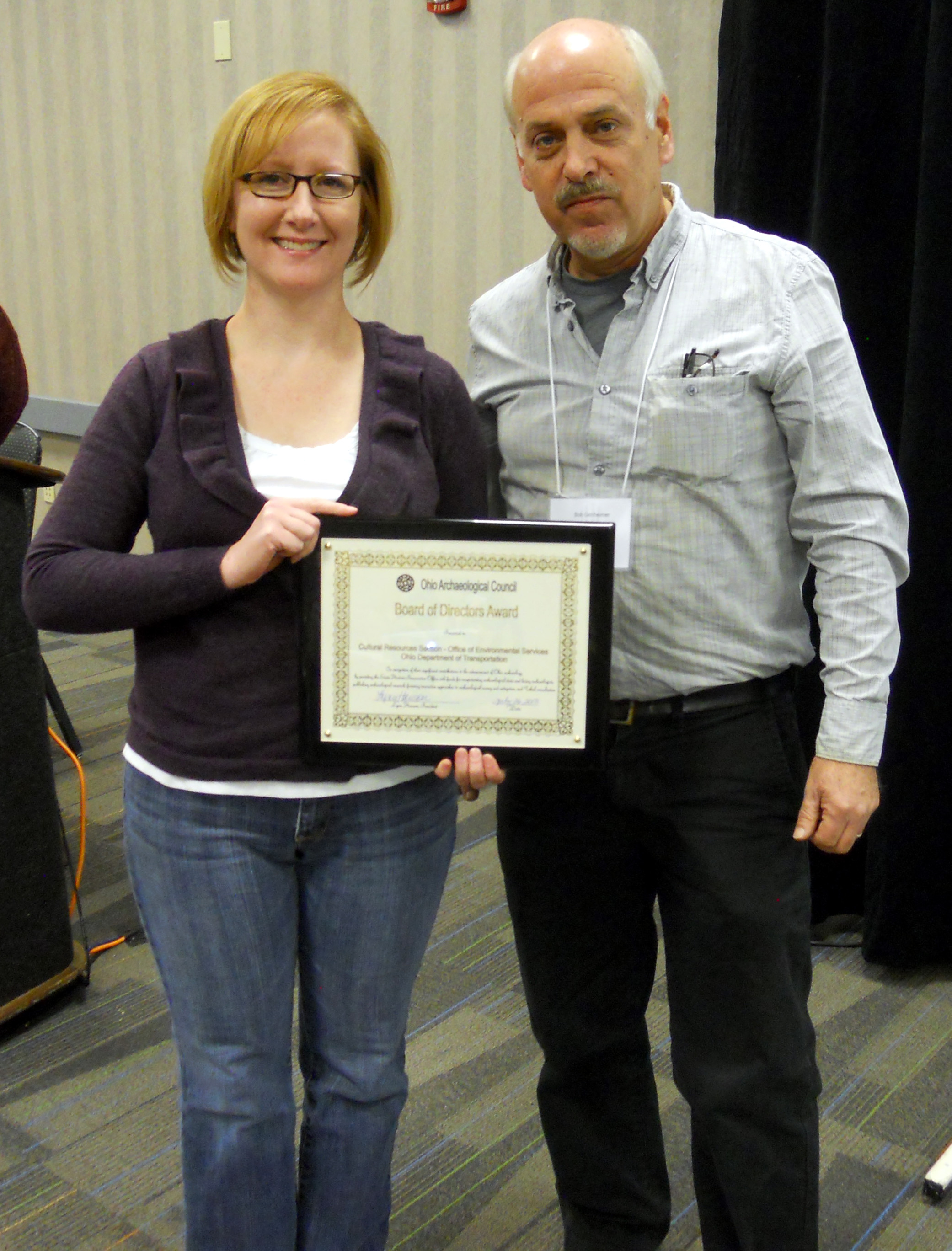 The OAC Board of Directors Award presented to Erica Schneider by President Bob Genheimer